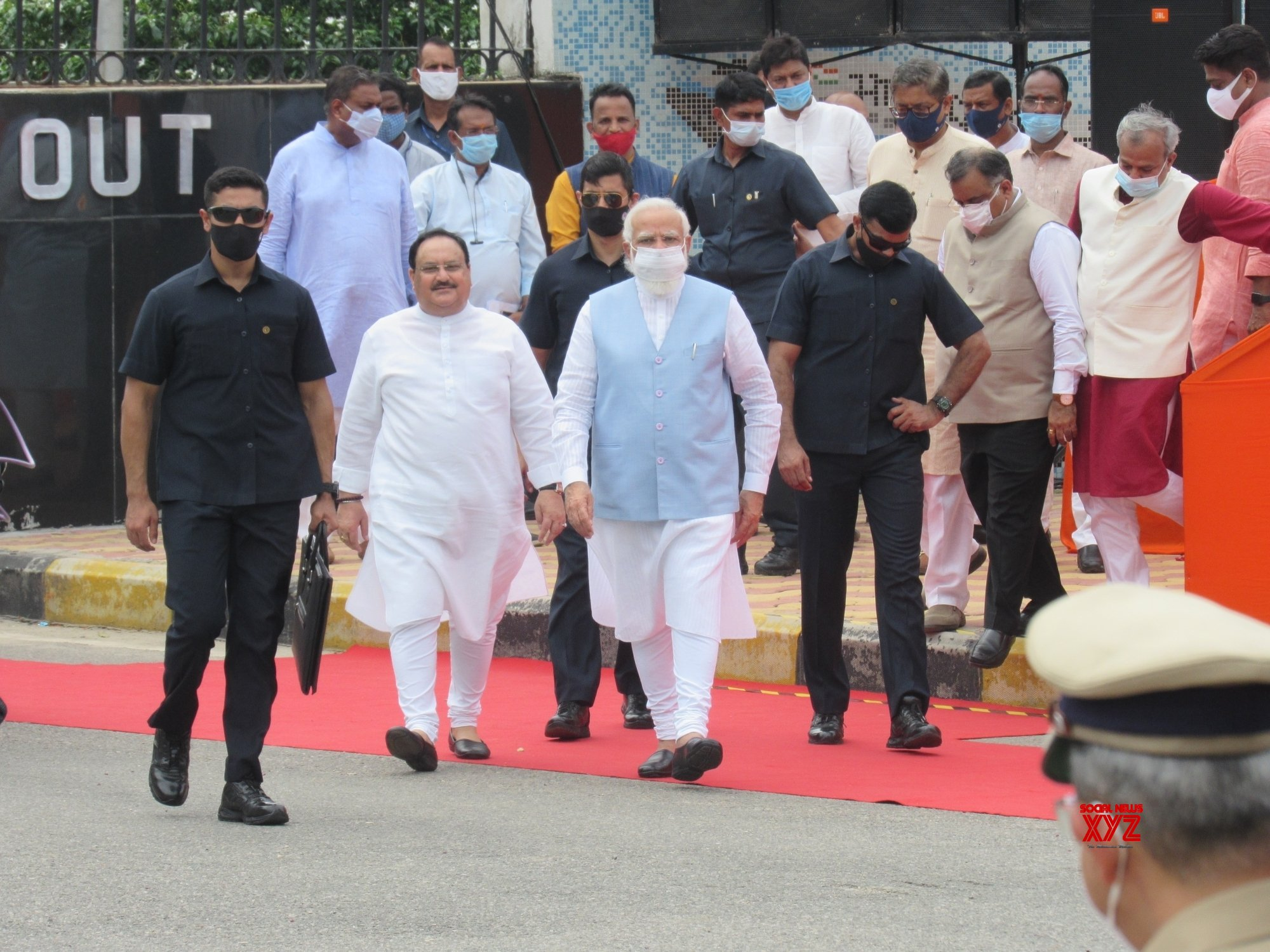 New Delhi: Prime Minister Narendra Modi welcomed by BJP leaders and supporters on his return to India from US visit, at Palam Airport in New Delhi. #Gallery