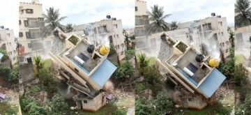 Bengaluru:Two storey residential building at NGO Colony in Kamala Nagar, collapsed in front of the grieving residents and onlookers,on Wednesday October 13,2021. no casualties were reported in the incident, .(PHOTO:IANS/Dhananjay Yadav)