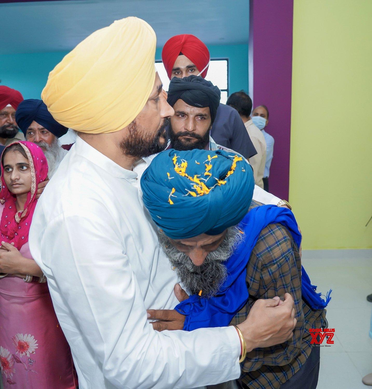 Amritsar:Amritsar: Punjab CM Charanjit Singh Channi console family members - of Martyr Sepoy Gajjan Singh before his last rites at his native Village Pachranda,Nupur Bedi in Rupnagar District in Punjab #Gallery