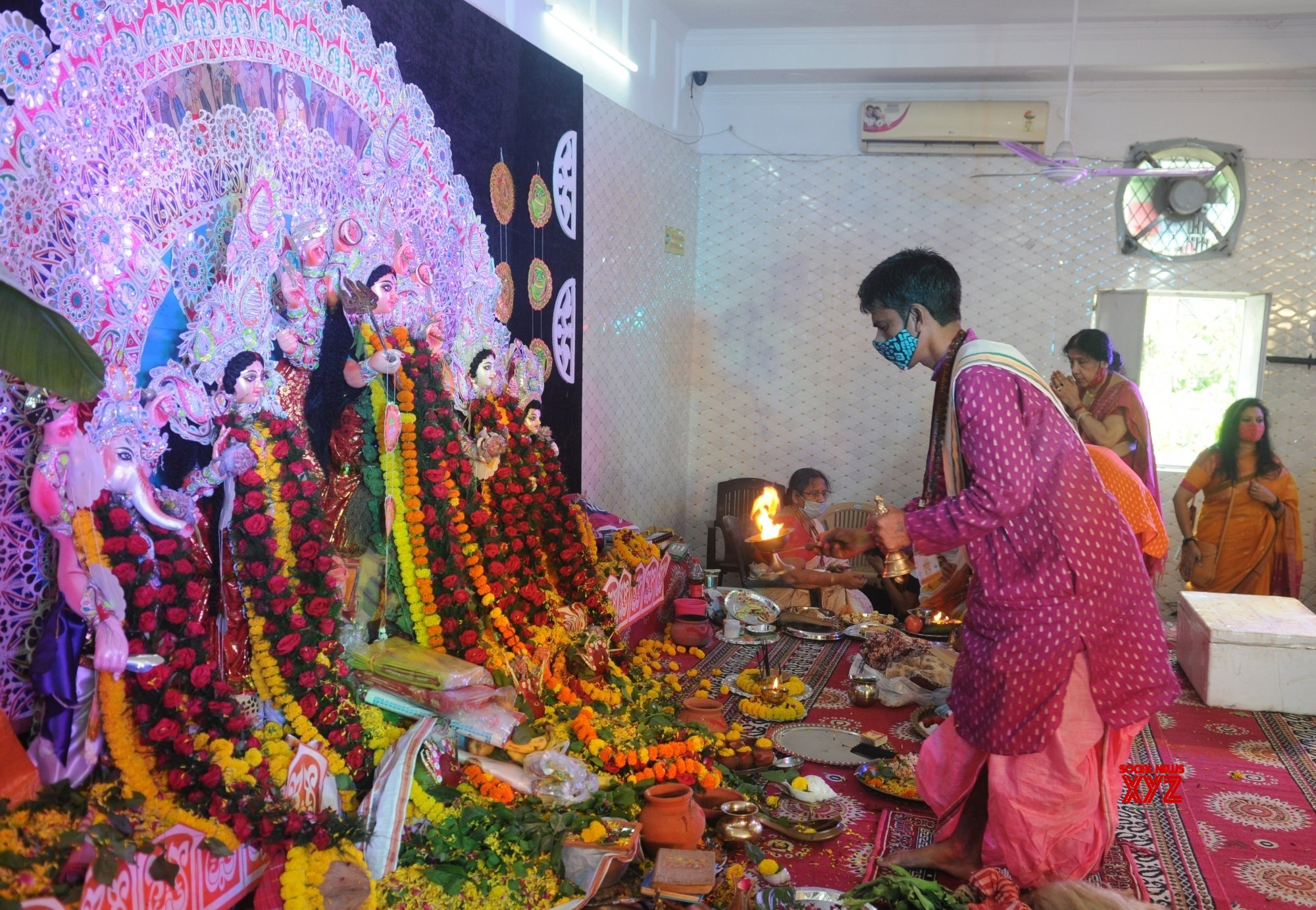 New Delhi:A priest performs arati to Goddess Durga on the occasion of Maha Asthami at a Community puja at Motia Khan #Gallery