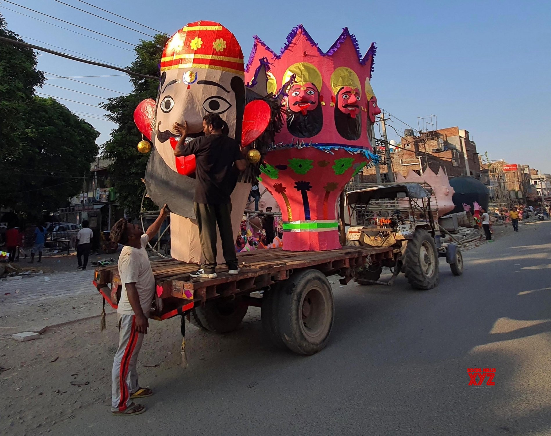 Amritsar:People carrying Effigies of the Ravana is on a tractor trolley for its installation on the eve of dussehra festival, the last day of the Navratri (nine nights) festival21) Amritsar: #Gallery