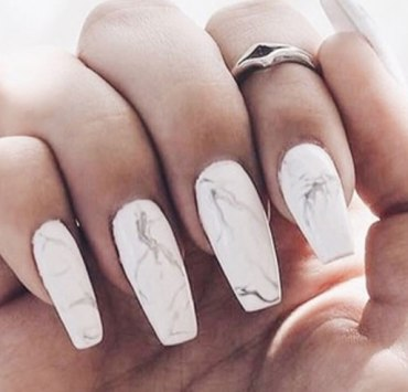 If you're looking for a fun DIY nail design to try out, give the marble nails look a go. Your nails willlook expensive, but you won't be breaking the bank!