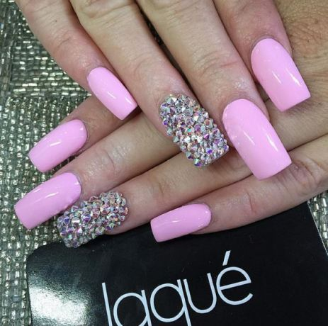 Try a basic nail color such as white or pink and add a bit of a sparkle to your look.