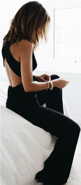 This backless black jumpsuit romper is perfect for a holiday party outfit!