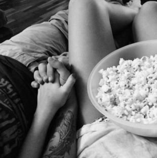 Having a movie night at home is a cute date night idea!