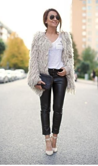 Adding a shaggy cream colored coat paired with leather leggings to your closet will be perfect for the fall!