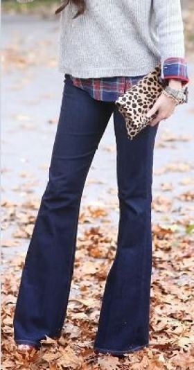 Flared jeans paired with a flannel and cozy sweater make for a perfect fall outfit!