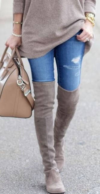 An over sized sweater and over the knee boots make for a perfect fall outfit!