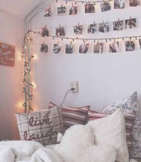 Hanging up photos of loved ones is a great way to decorate a dorm room.