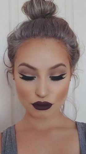 This dark lip looks so good with her hair!