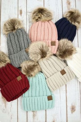 These pom pom hats are so cute for a winter outfit!