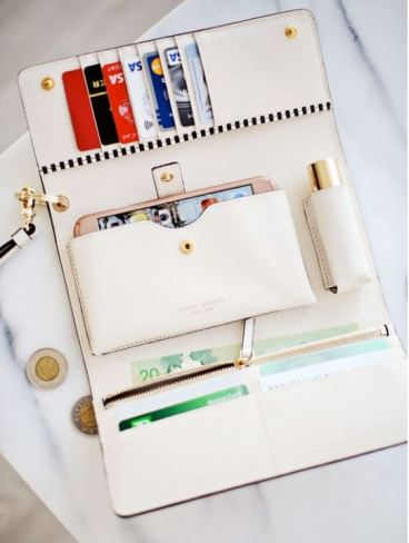 This white Kate Spade Wristlet is perfect!