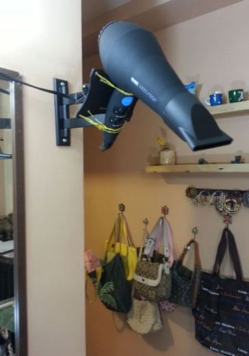 A DIY hairdryer holder is a great idea!
