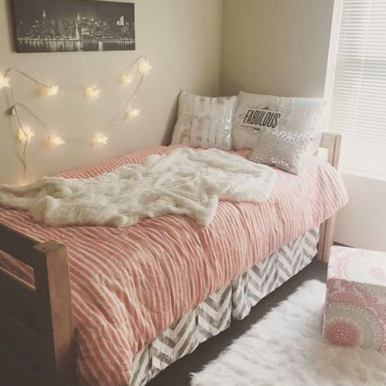 Throw rugs are a simple way to decorate your dorm room on a budget!