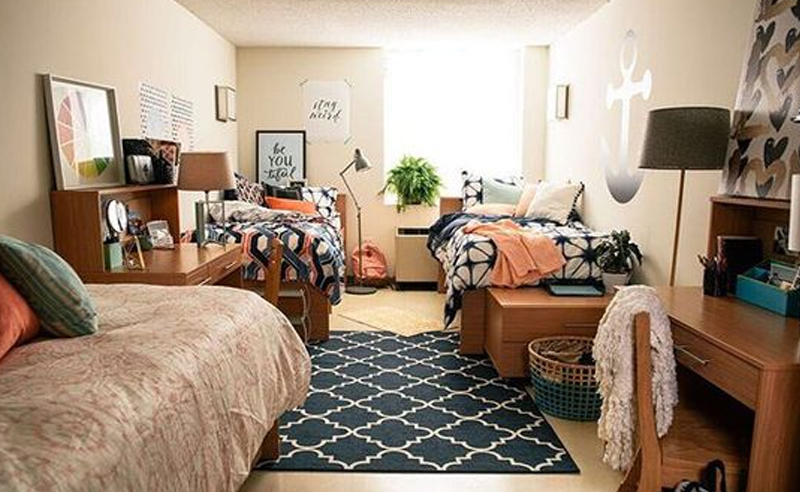 Dorm rooms are small enough, never mind being stuck in a triple. It can be hard to make space for everything. Here is how to organize your dorm room!