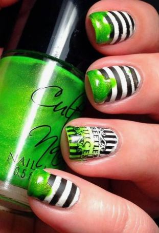 This Beetlejuice design is a great Halloween nail art design.