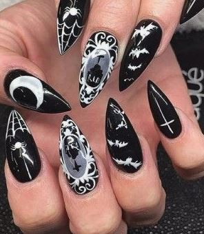 These gothic nails are a great Halloween nail art design.