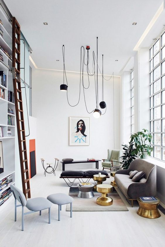 Try one of the best cute living room ideas with brass features and industrial lighting.