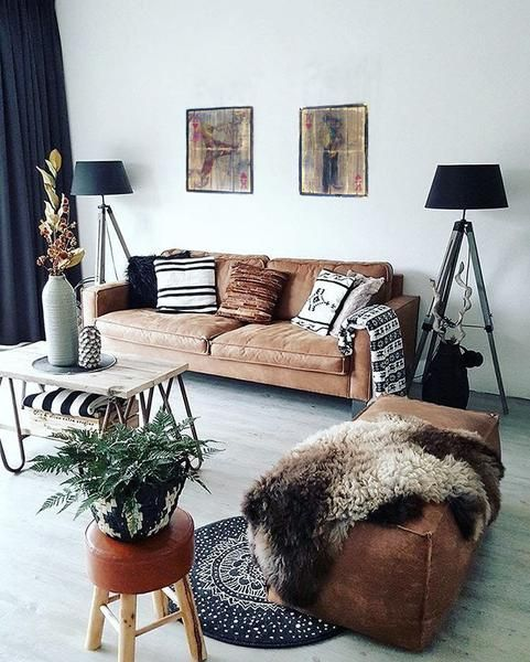 Try one of the best cute living room ideas with weathered leather and blurred artwork.