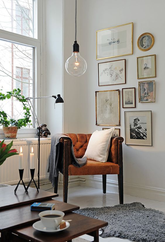 Try one of the best cute living room ideas with mixed-metal gallery walls and hang lights.