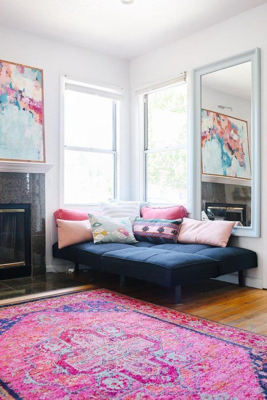 Try one of the best cute living room ideas with faded Persian rugs and bright hues.