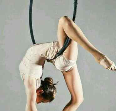 If you're into aerial fitness classes that include hanging off of fabrics chained to the ceiling, or twirling around a pole, then you've probably heard of an aerial hoops class.