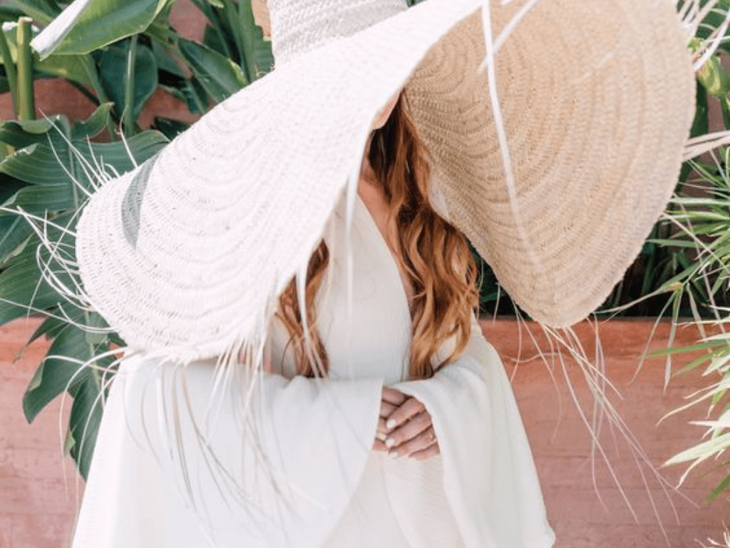 8 Hairstyles To Wear With A Hat This Summer