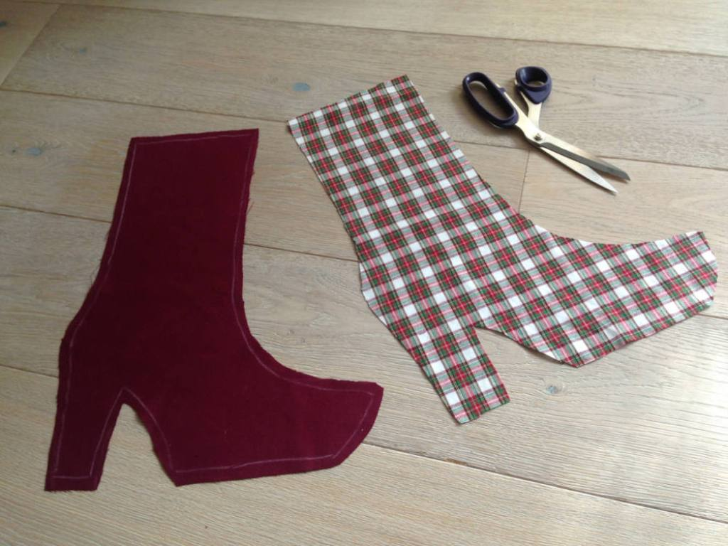 Lay pieces of the Christmas stocking over each other  how to sew a christmas stocking easy
