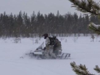 10th Special Forces Group Soldiers riding a snowmobile during Winter Warfare training. (Photo from video by SSG William Reinier, 10th SFGA, Oct 25, 2017).