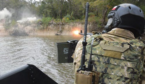 NAVSCIATTS PCAT student fires weapon during scenario driven field training exercise. (Photo from NAVSCIATT Guide Book, April 2017).
