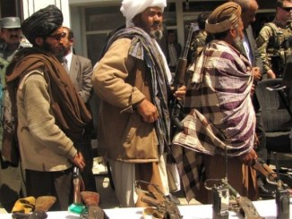 Former Taliban turn in their weapons during an APRP ceremony in Ghor province, Afghanistan on May 28, 2012. Photo by Lt JG Joe Painter, DoD.