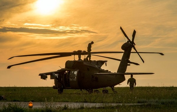 U.S. Soldiers assigned to the 2nd General Support Aviation Battalion, 4th Aviation Regiment, 4th Combat Aviation Brigade, 4th Infantry Division, conduct safety checks and prepare their UH-60 Blackhawk for air assault training at Mihail Koglniceanu Air Base, Romania, July 10, 2018. The Soldiers of 2nd GSAB are conducting similar training in multiple locations throughout Europe in support of Atlantic Resolve, a U.S. endeavor to fulfill NATO commitments by rotating U.S.-based units throughout the European theater to deter aggression against NATO allies and partners in Europe. (U.S. Army photo by Spc. Andrew McNeil / 22nd Mobile Public Affairs Detachment)