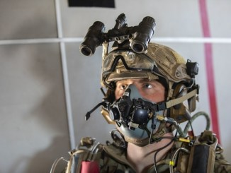 Jump Eloy DZ. Jumper prepares to exit airplane over Tunnel Drop Zone, Eloy, Arizona. Photo by Specialist Christopher Stevenson, 10th SFGA, September 17, 2018.