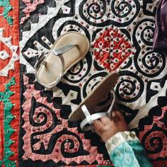 We celebrated Eid the day before we left. The Baby wore turquoise silk and these adorable silver sandals from Gap Kids.