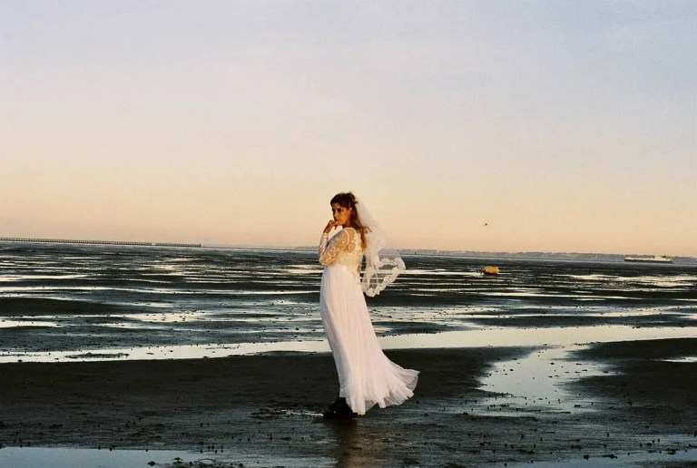 Natalie Shay runs away from the altar in video for 'Naked'
