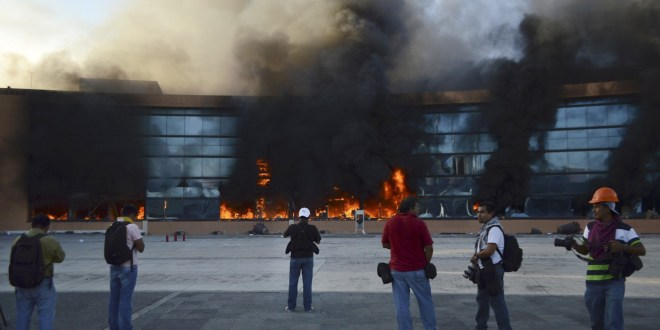 Protesters burn Mexican city's government offices over suspected murder of students