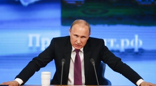 Putin predicts economic recovery but warns West against pressuring Russian 'bear'