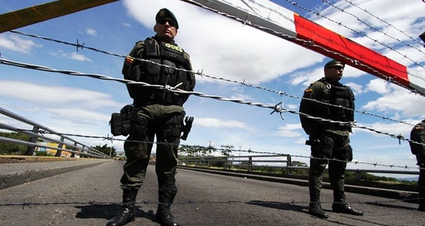 Venezuela closes key crossing with Colombia after three soldiers shot
