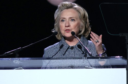 Clinton says she doesn't back declaration of war against IS