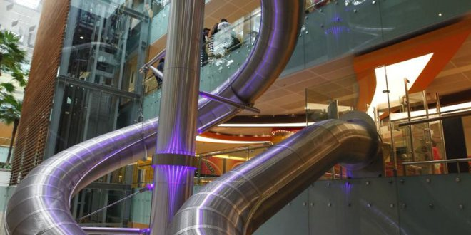 This Airport Has a Massive Slide That Will Take You to Your Gate | Travel and Leisure
