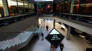 Stock markets stabilise after China trade warning | BBC
