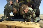 Soldiers loading MRE boxes
