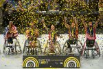 Soldiers in wheelchairs celebrate winning basketball