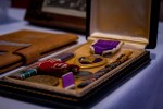A veteran's, purple heart and other medals in a case.
