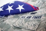 Air force uniform with folded American flag on top