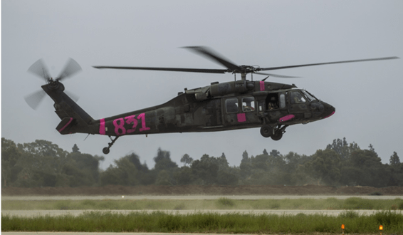 The reason these military helicopters are painted pink | We Are the Mighty
