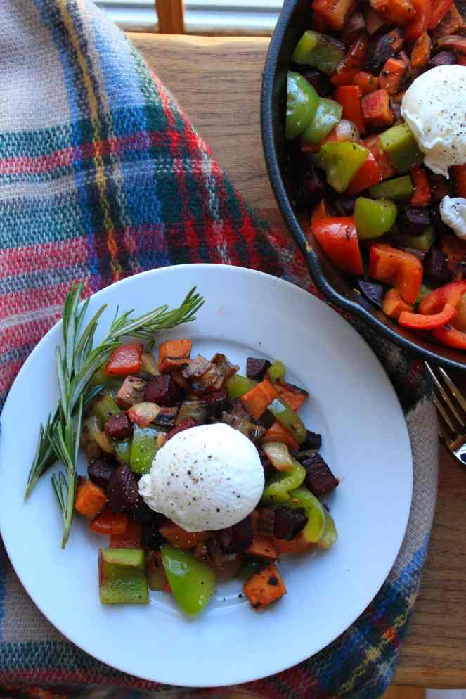 This festive Red Flannel Hash is a healthy and delicious brunch option on a cold winters day. Peppers, sweet potatoes, onion, and beets are roasted to perfection, serving as a colorful bed for poached jammy eggs. | #SoHappyYouLikedIt