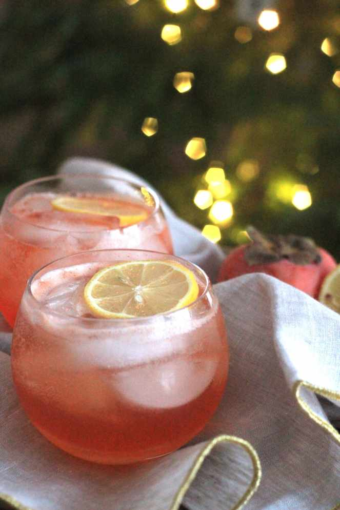 The Persimmon Aperol Spritz: a light, effervescent, and festive cocktail to ring in the New Year! Persimmon and lemon infused simple syrup gives this cocktail it's sweetness, while being offset by the bitterness of the Aperol. Topped with some bubbly, and you're ready to ring in the New Year! | #SoHappyYouLikedIt
