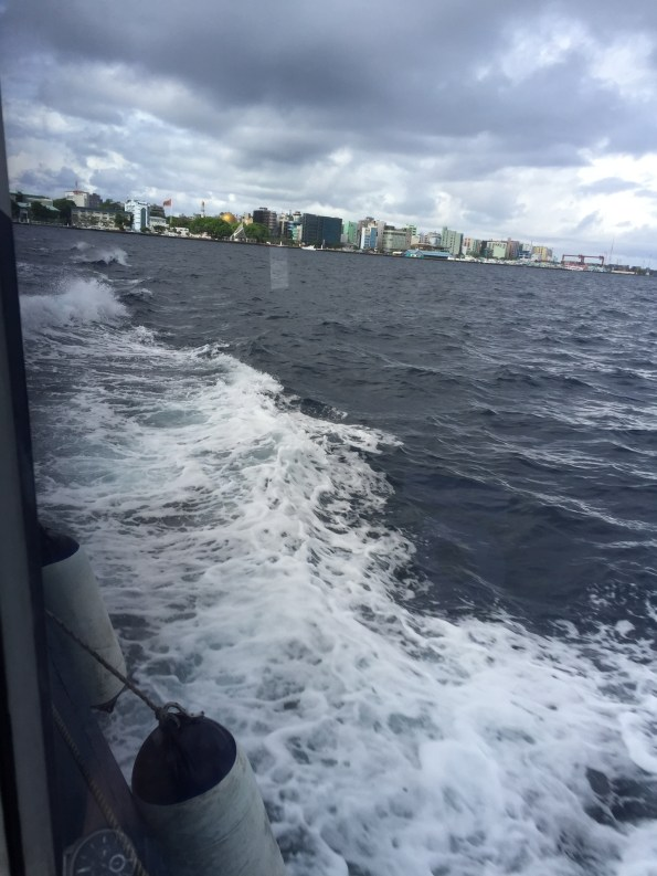 Aboard the ferry with Male' in the backdrop