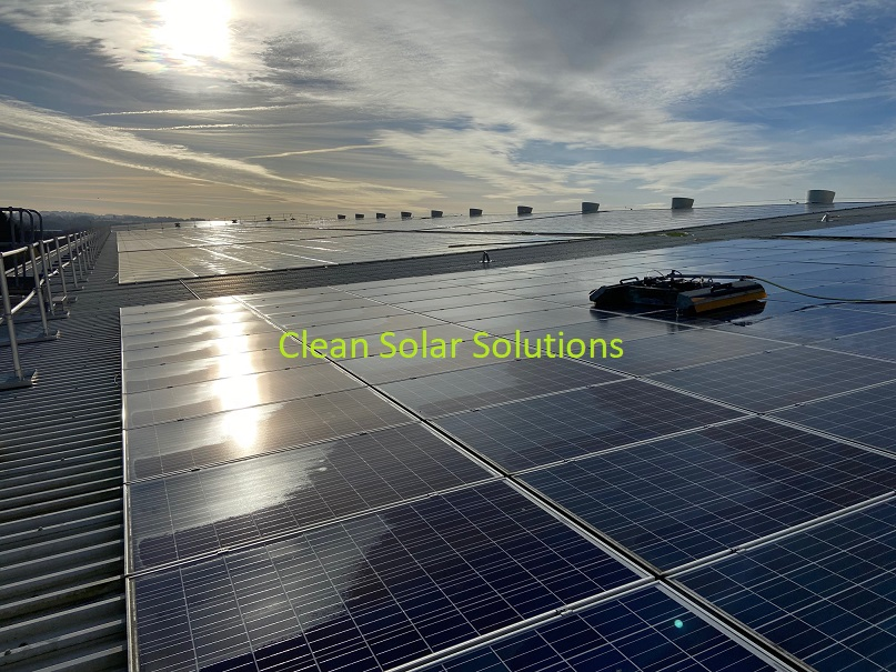 robot cleaning solar panels on a roof